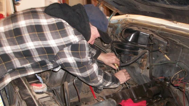 George Frank adjusting the valves
